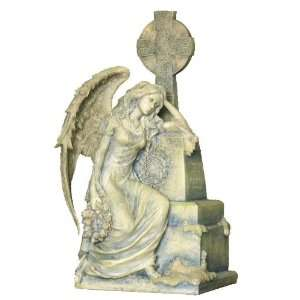 Gothic Weeping Angel Sitting and Leaning on a Grave